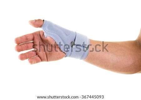 Close Up of Man Wearing Modern Supportive Orthopedic Brace on Wrist, Hand and Thumb, Secured by Velcro Strap, in Studio with White Background and Copy Space - stock photo