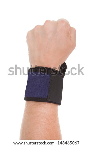 Close Up Of Man Wearing Wrist Band In Hand Over White Background - stock photo
