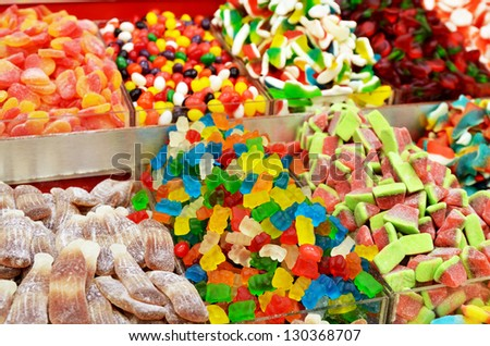 close up of many colorful candies on market stand - stock photo