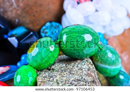 Close up of many different colorful natural gems: agate onyx, coral - stock photo