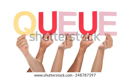 Close-up Of Many Hands Holding The Colorful Word Queue - stock photo