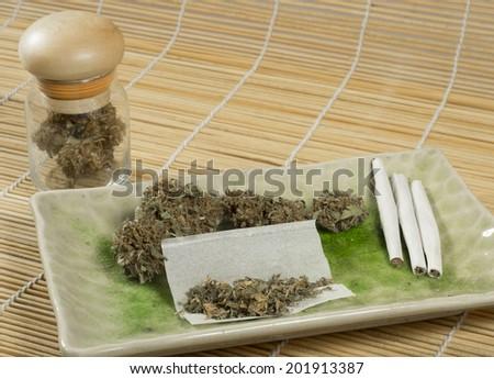 close up of marijuana cigarettes and medical marijuana - stock photo