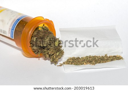 close up of marijuana cigarettes and medical marijuana - stock photo