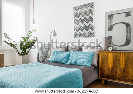 Close-up of marriage bed in cozy bedroom - stock photo