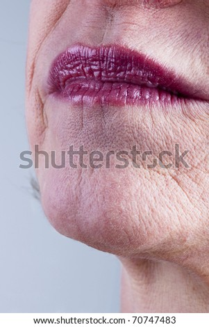 Close-up of mature woman mouth - stock photo