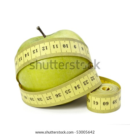 close up of measure tape and green apple on white background with clipping path - stock photo