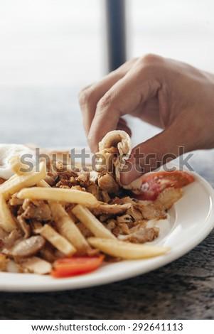 Close Up Of Men's Hand Taking Tandoori Chicken - stock photo