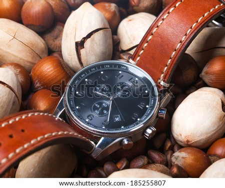 Close-up of men's watch with brown leather strap - stock photo