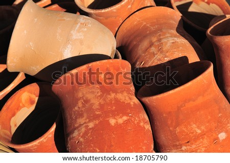 Close-up of Mexican earthenware pottery - stock photo