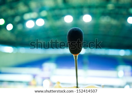 Close up of microphone in auditorium. - stock photo