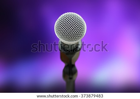Close-up of microphone in concert hall or conference room - stock photo