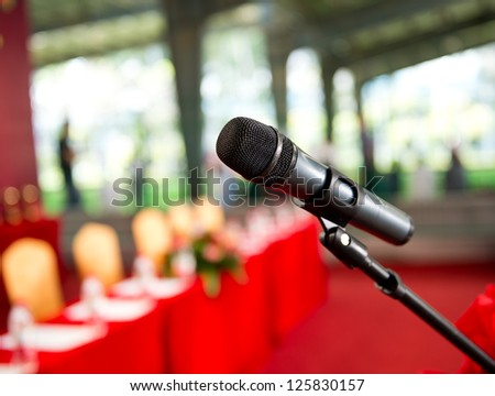 Close up of microphone in  conference room. - stock photo