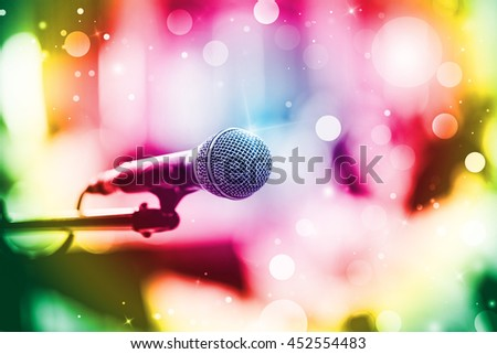 Close up of microphone in  conference room or concert hall. Vintage or retro tone. - stock photo