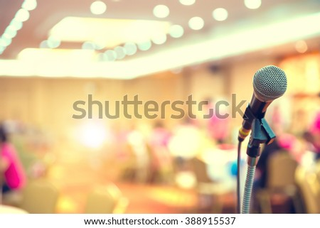 Close up of microphone in Meeting room hall or conference room - stock photo