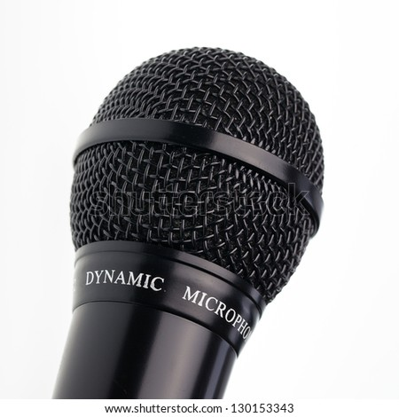 Close up of microphone on isolated white background - stock photo