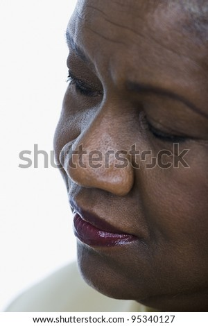 Close-up of middle-aged woman's face - stock photo