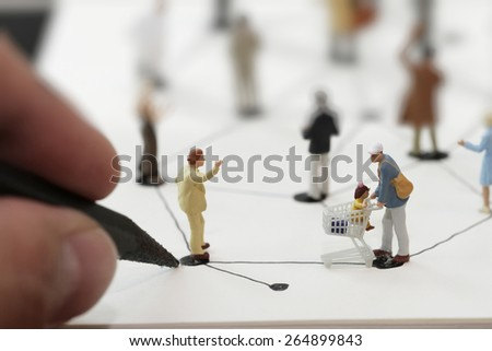 close up of miniature people with hand drawing social network diagram on open notebook on wooden desk as social media concept - stock photo