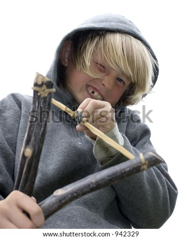 close-up of mischievous boy with slingshot - stock photo