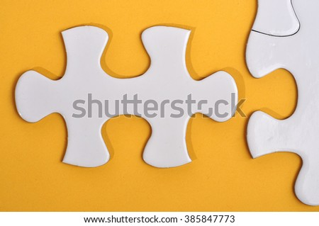 Close Up of Missing Puzzle on Yellow Background, Searching a Solution and Business Concept - stock photo