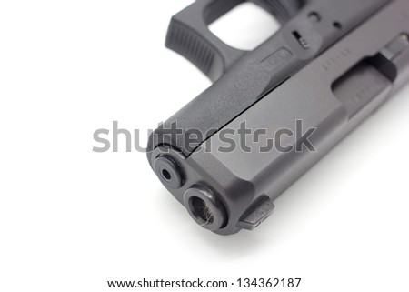 Close up of 9mm pistol isolated on white background - stock photo