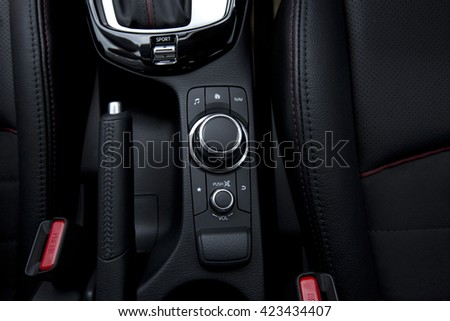 close up of modern car audio entertainment control button - stock photo
