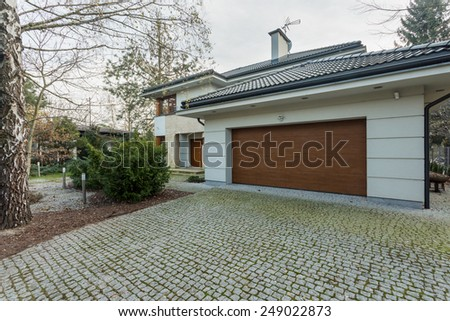 Close-up of modern detached house with garage - stock photo