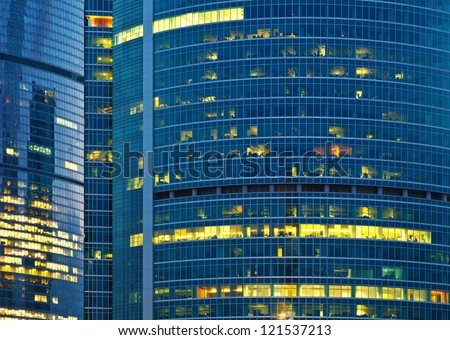 Close up of modern skyscraper illuminated at night - stock photo