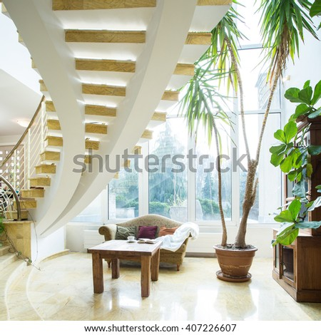Close-up of modern spiral stairs in luxury villa - stock photo