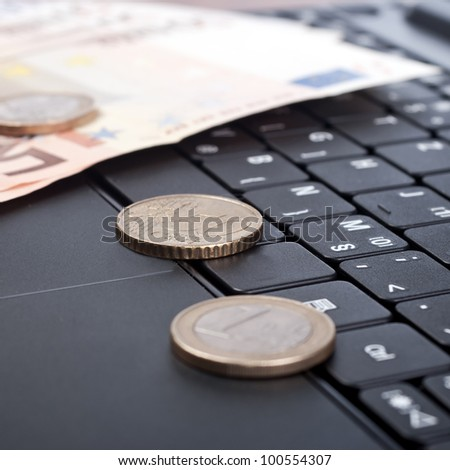 close up of money on the keyboard - stock photo