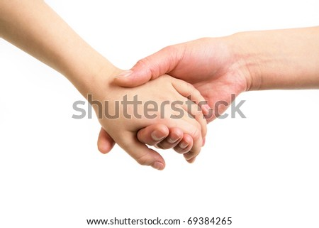 Close-up of mother and child holding by hands - stock photo