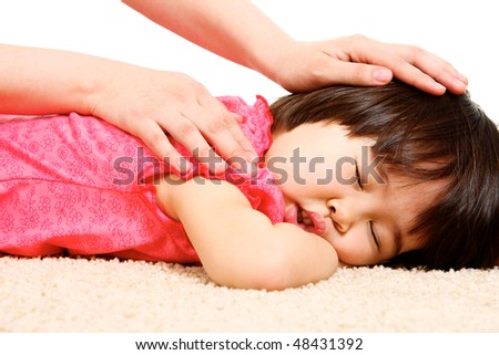 Close-up of mother?s hands touching her sleeping daughter - stock photo