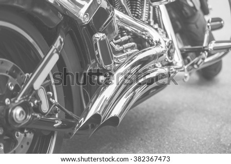 close up of motorcycle exhaust, old black and white, noise - stock photo