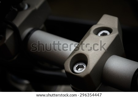Close up of motorcycle handlebar clamp - stock photo