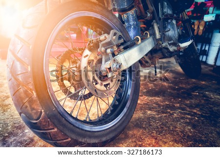 close up of motorcycle wheel, focus tyre - stock photo