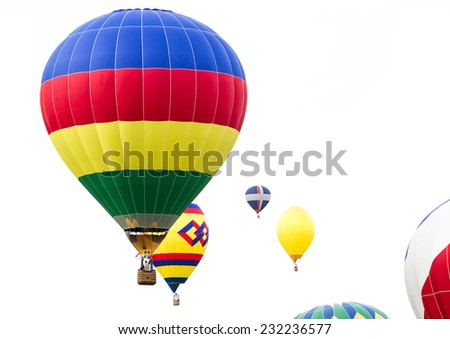 close up of multiple hot air balloons in mid air in Albuquerque New Mexico - stock photo