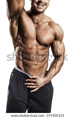 Close-up of muscular man isolated over white background - stock photo