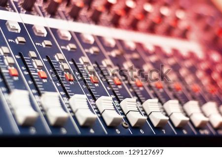 Close-up of music mixer in audio studio - stock photo