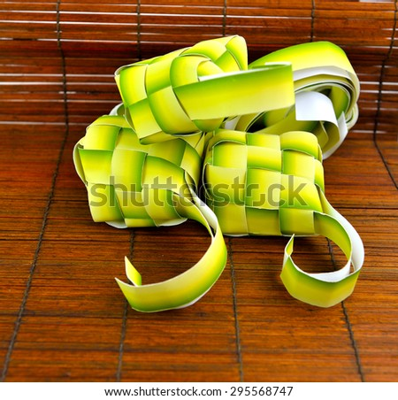 Close up of muslim ketupat (rice dumpling) isolated on texture background, selective focus.  - stock photo