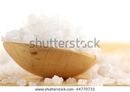 Close-up of natural salt of Dead Sea in wooden spoon on white background. - stock photo