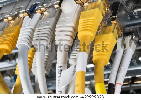 close-up of network hub and ethernet cables - stock photo