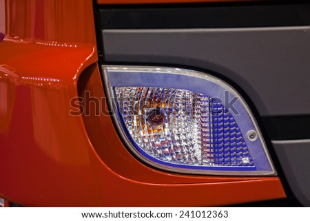 close up of new firefighters truck headlights - stock photo