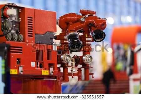 close up of new firefighters truck with firefighting equipment - stock photo