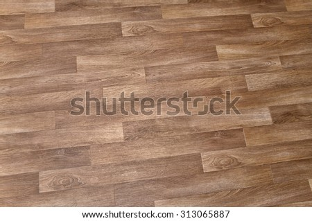 Close-up of new linoleum with parquet pattern, background - stock photo