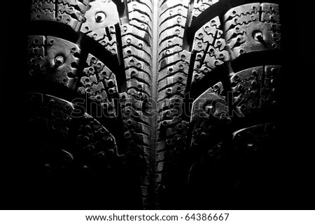 Close-up of new winter tire. In B/W - stock photo