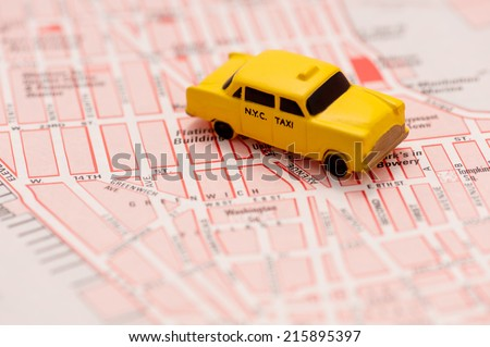 Close up of New York city map with a yellow taxi on it taxi - Travel concept. - stock photo