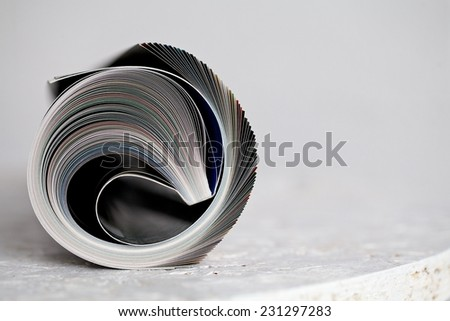 Close up of newspapers and magazine on white background - stock photo