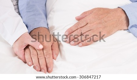 Close-up of nurse caring about ill man - stock photo