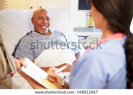 Close Up Of Nurse Updating Patient Notes - stock photo