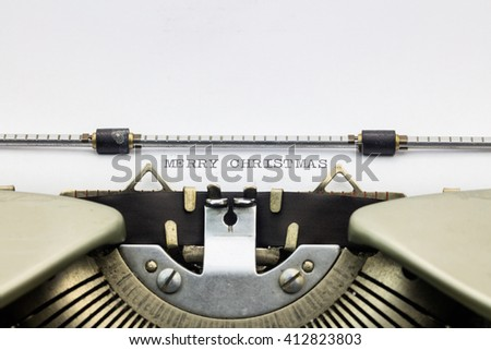 Close-up of of words Merry Christmas  on typewriter sheet - stock photo