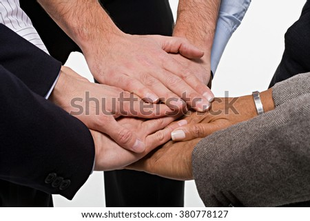Close up of office workers showing unity - stock photo